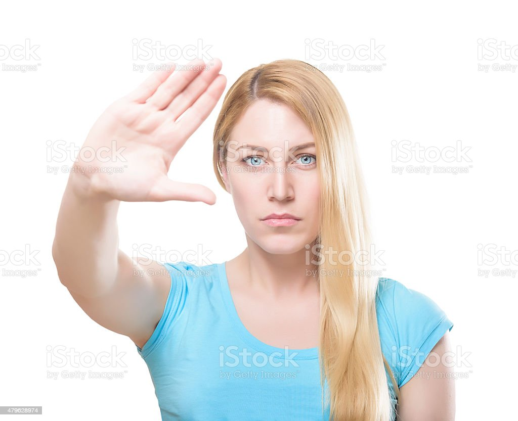 Attractive blonde woman with her hand holding it at arm stock photo