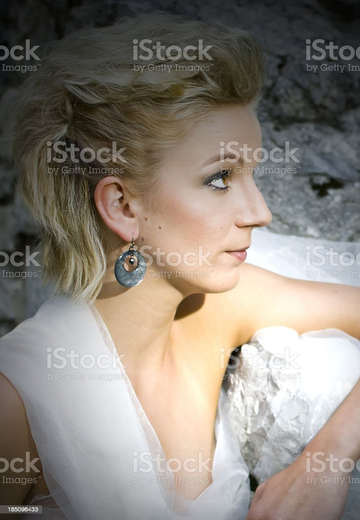 Attractive blonde woman with wedding hairdress stock photo