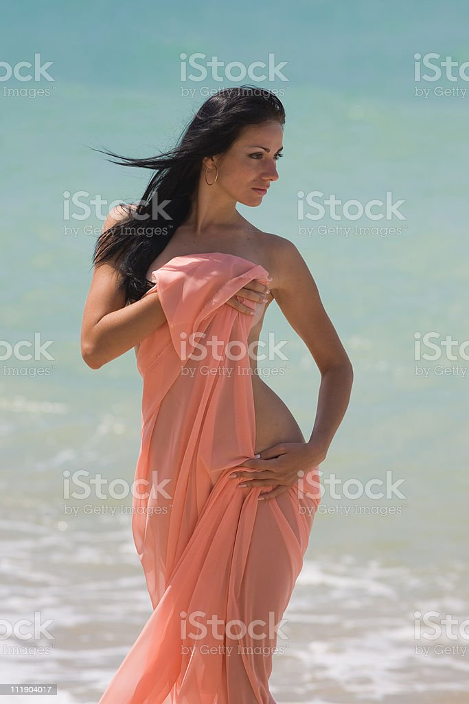 Attractive brunette at the sea. royalty-free stock photo