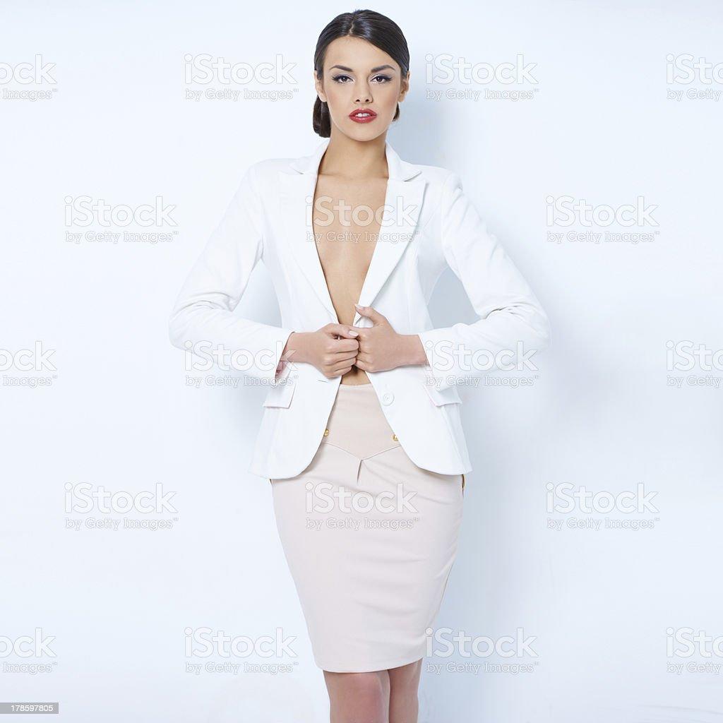 Attractive brunette business woman wearing jacket stock photo