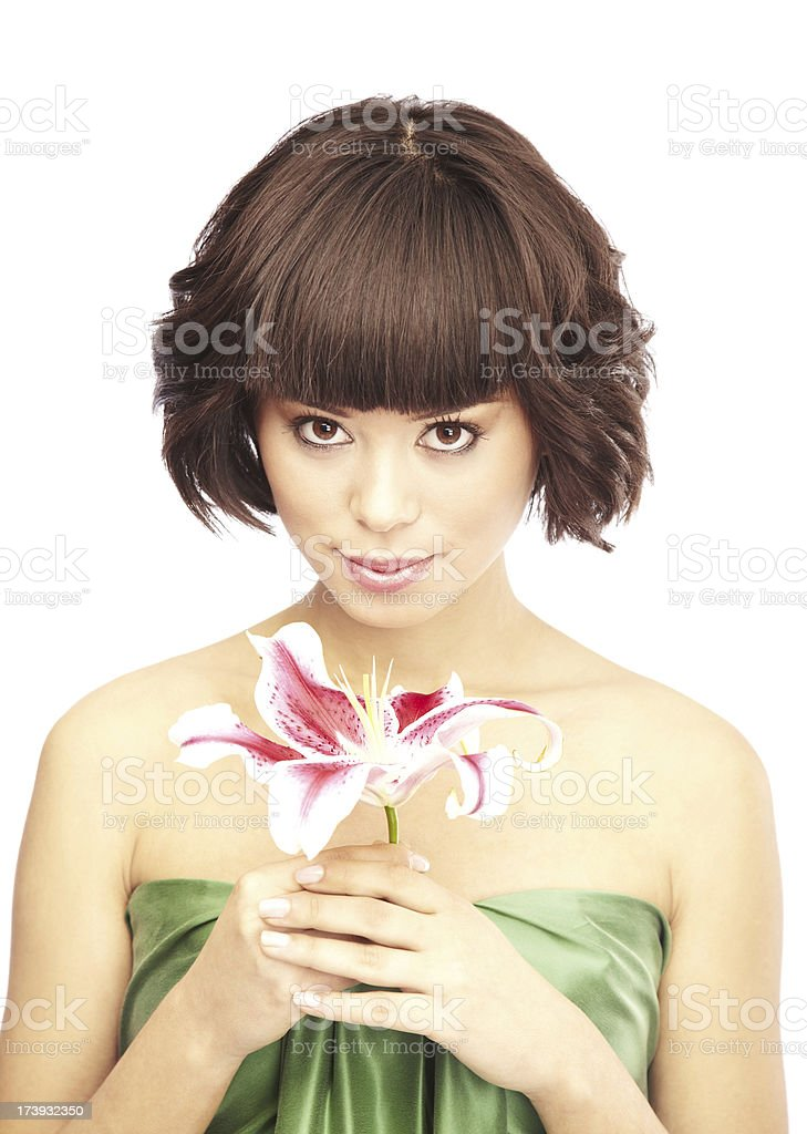 Attractive Brunette Holding a Stargazer Lily Flower royalty-free stock photo