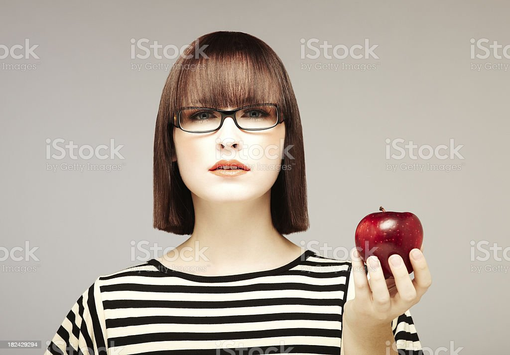 Attractive Brunette Holding an Apple stock photo