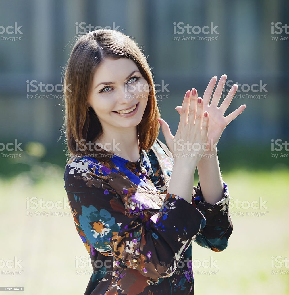 Attractive brunette in blouse outdoors royalty-free stock photo