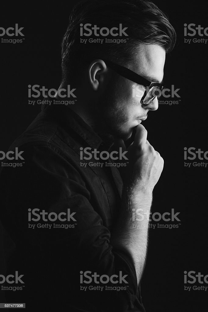 Attractive brunette man on black shirt and glasses stock photo