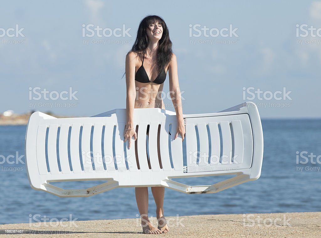 Attractive brunette on the beach royalty-free stock photo