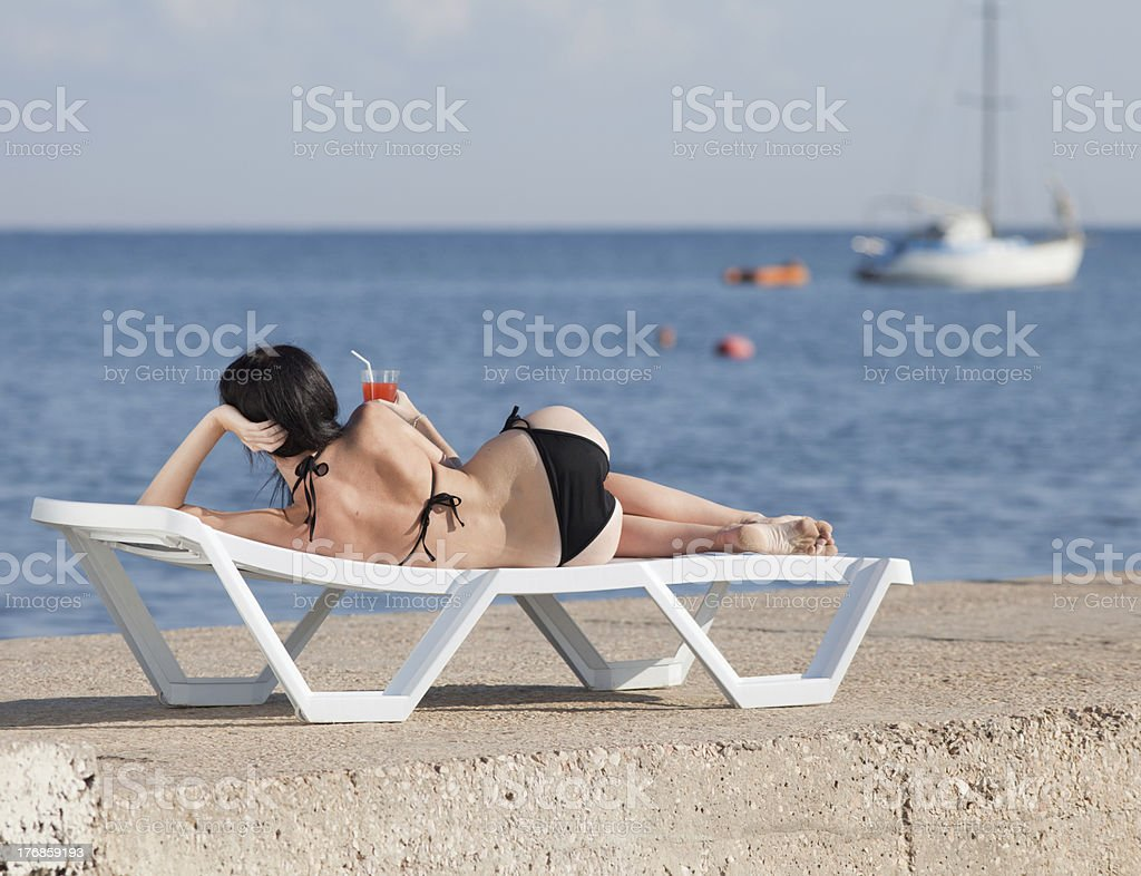 Attractive brunette on the beach stock photo