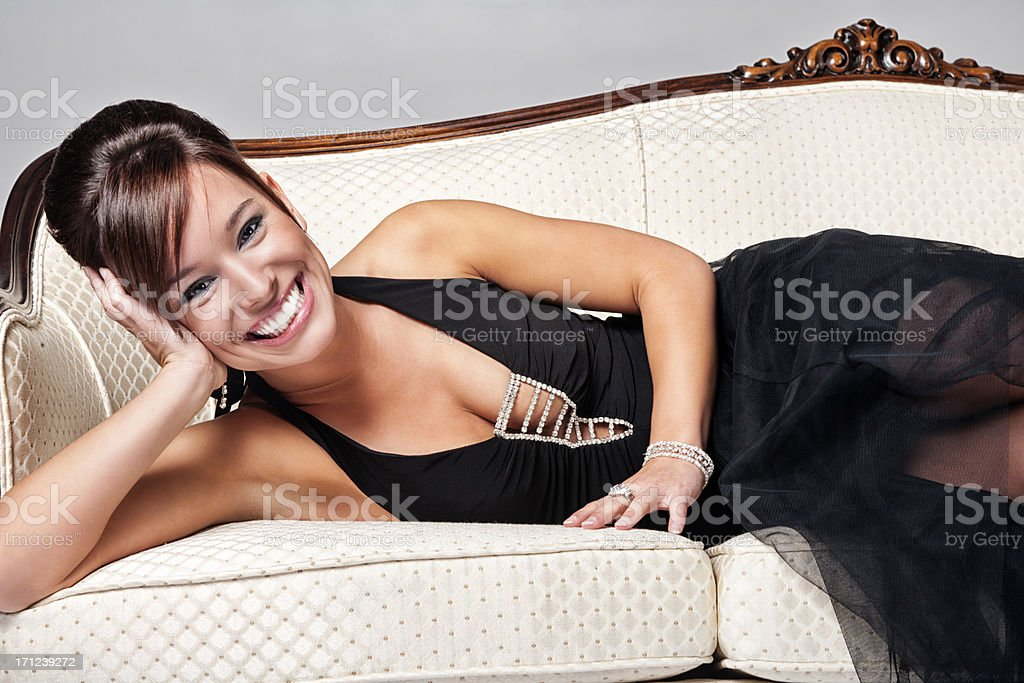 Attractive Brunette Posing on Antique Sofa royalty-free stock photo