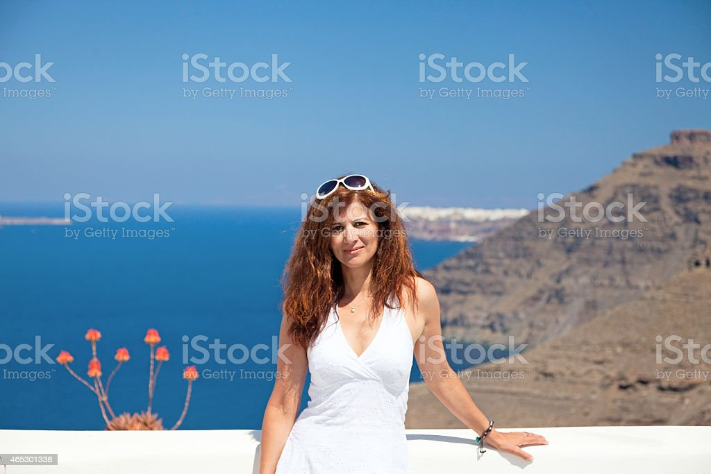 Attractive  brunette posing on  the sea background stock photo