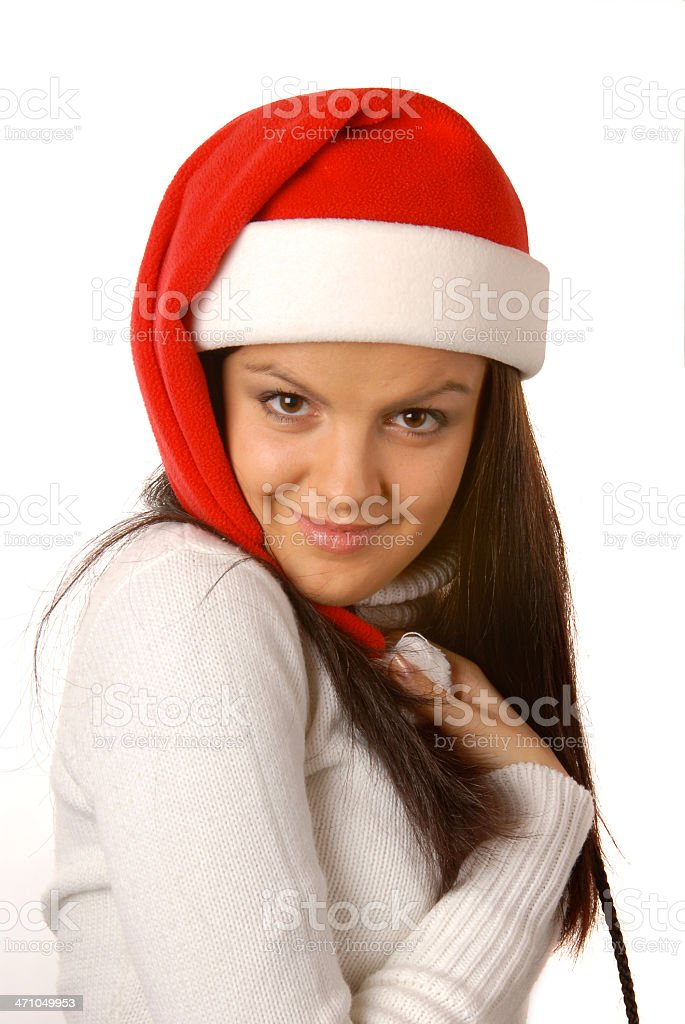 Attractive brunette with a Christmas hat royalty-free stock photo