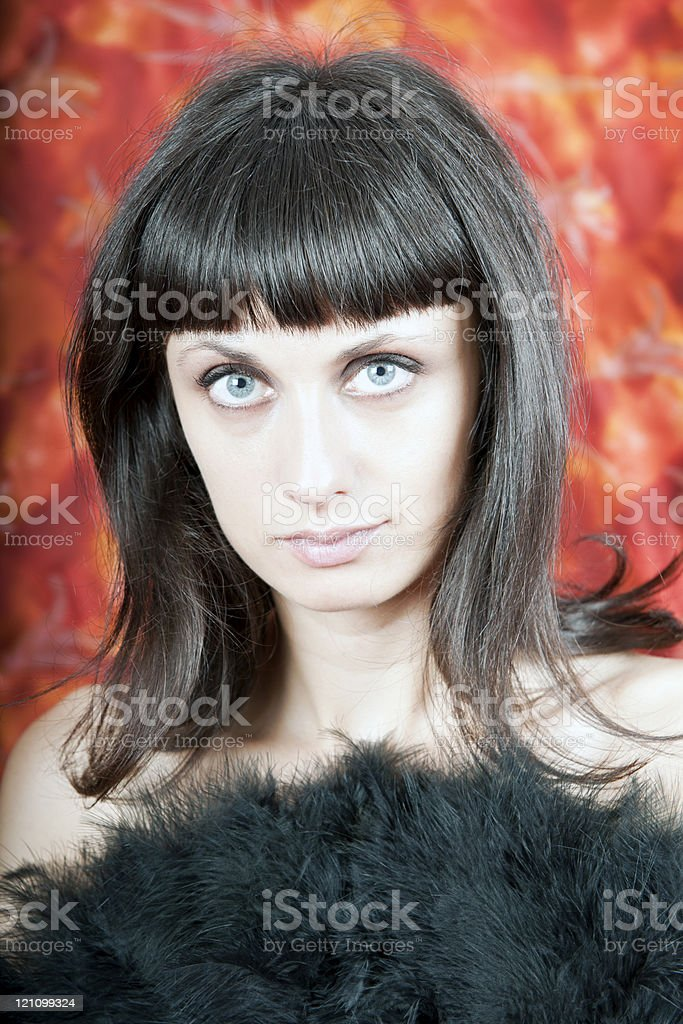 Attractive Brunette with Black Feather Fan royalty-free stock photo