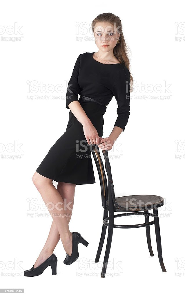 Attractive brunette woman holding on chair royalty-free stock photo