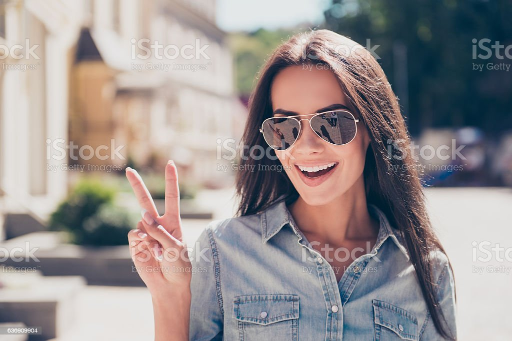 Attractive brunette woman in glasses having walk stock photo