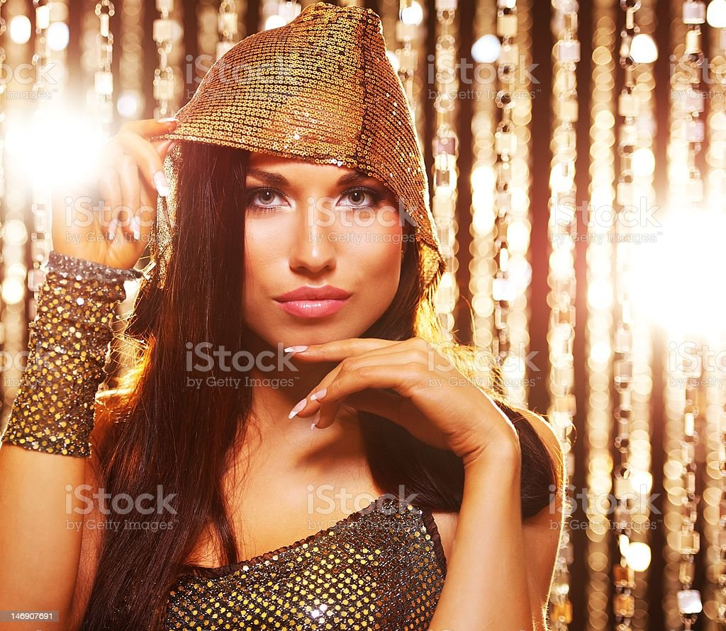 Attractive brunette woman over abstract background royalty-free stock photo