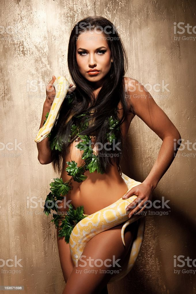 Attractive brunette woman with albino python stock photo