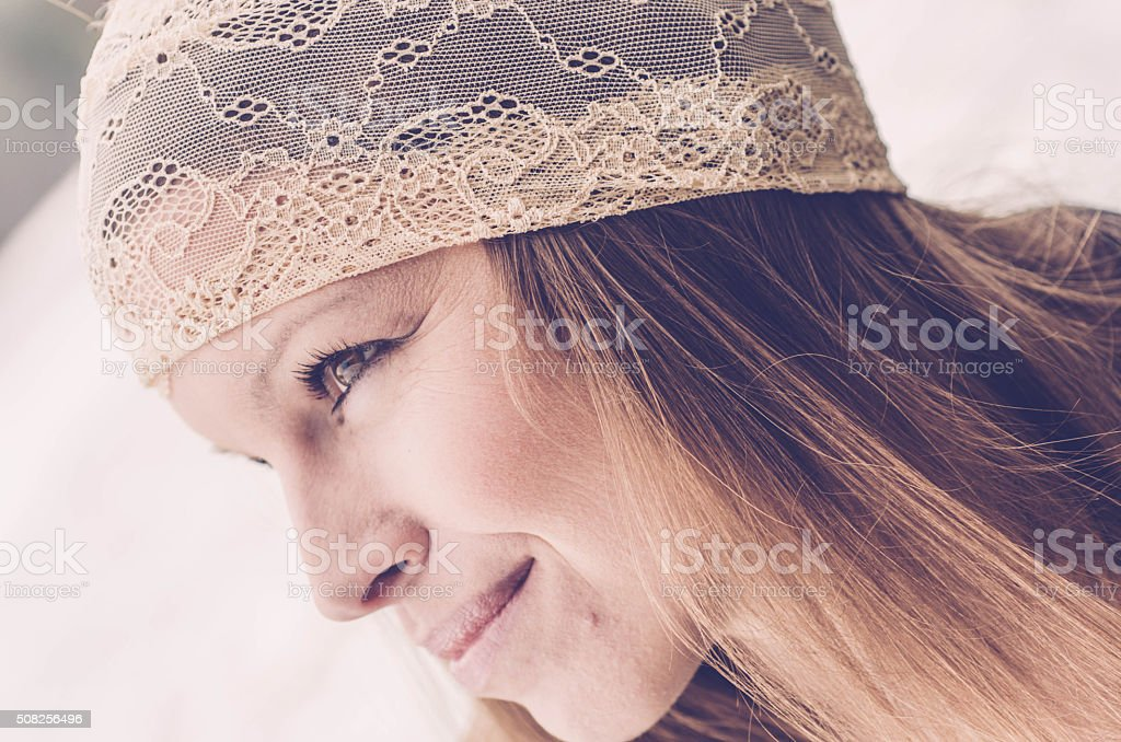 Attractive Brunette Woman with Lace Hair Band stock photo