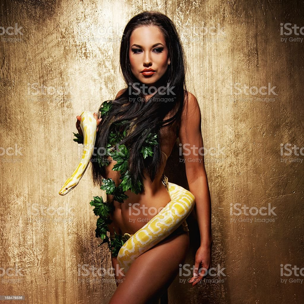 Attractive brunette woman with python stock photo