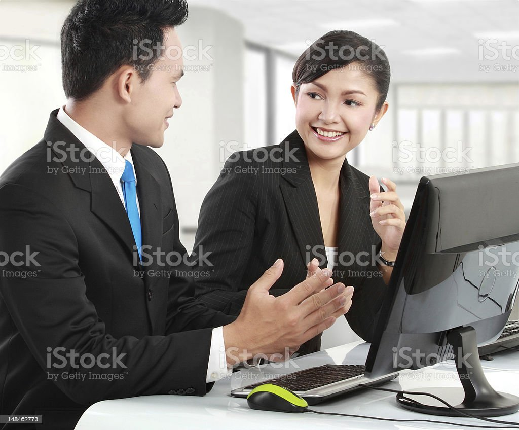 Attractive business associates talking royalty-free stock photo