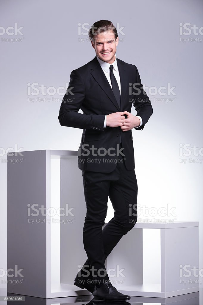 attractive business man closing his jacket stock photo