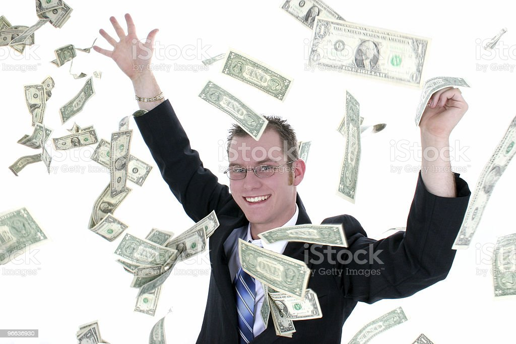 Attractive Business Man In Suit Throwing Money Into Air royalty-free stock photo