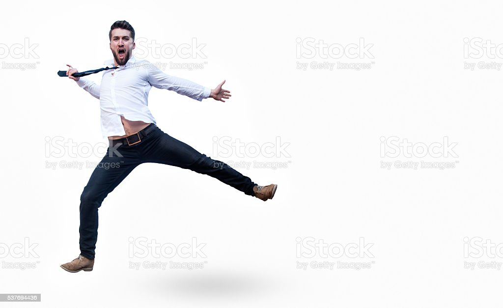 Attractive business man is jumping in the air stock photo