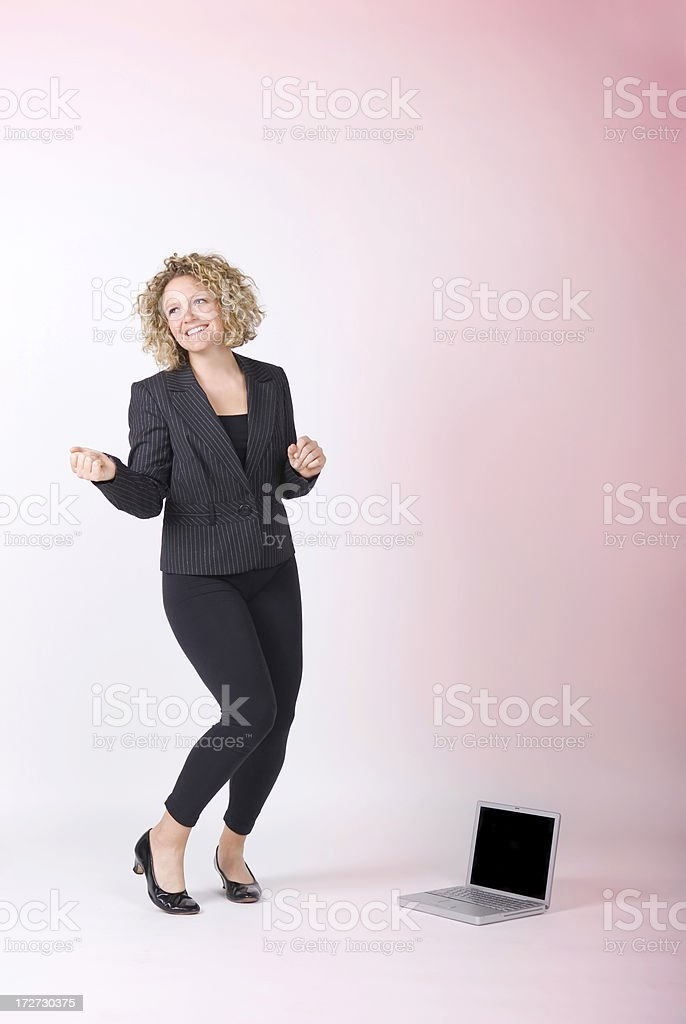 Attractive Business Woman Dances with Computer royalty-free stock photo