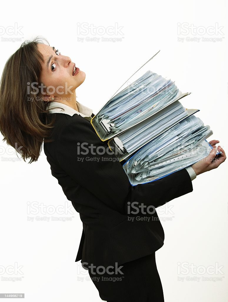 Attractive business woman overloaded with files royalty-free stock photo
