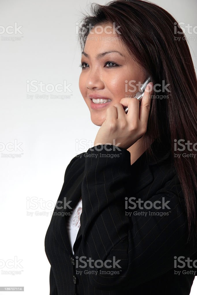 Attractive business woman talking on cell phone royalty-free stock photo