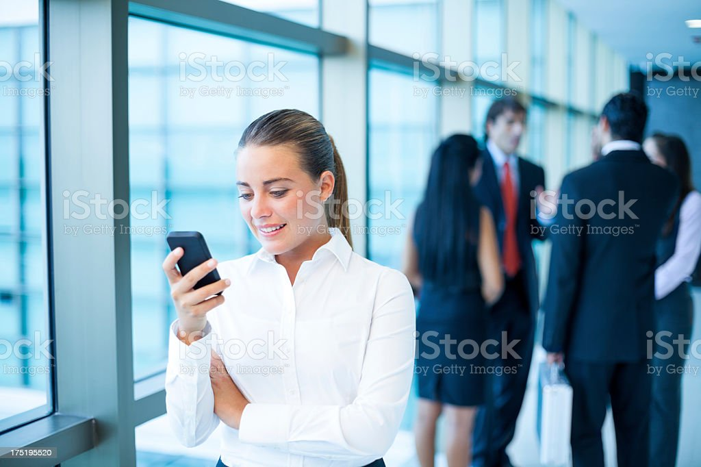 Attractive business woman texting royalty-free stock photo
