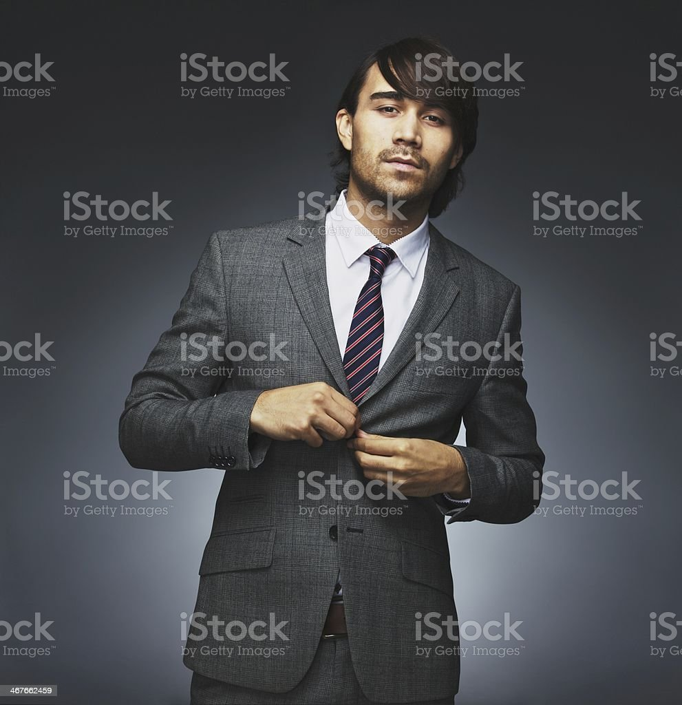 Attractive businessman getting dressed on black background stock photo