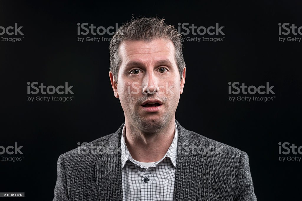 attractive businessman portrait looking surprised at camera stock photo