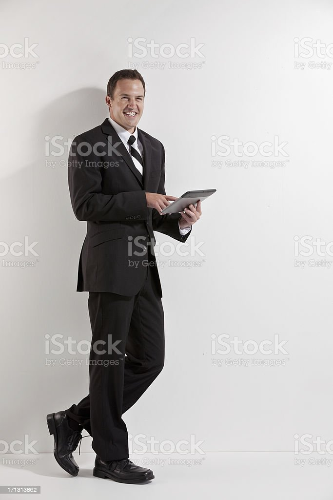 Attractive businessman using a digital tablet royalty-free stock photo