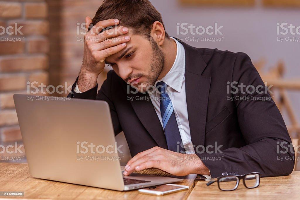 Attractive businessman working stock photo