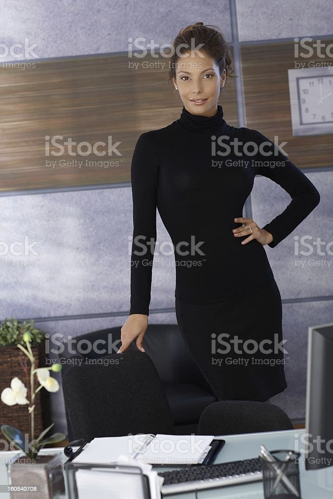Attractive businesswoman at desk royalty-free stock photo