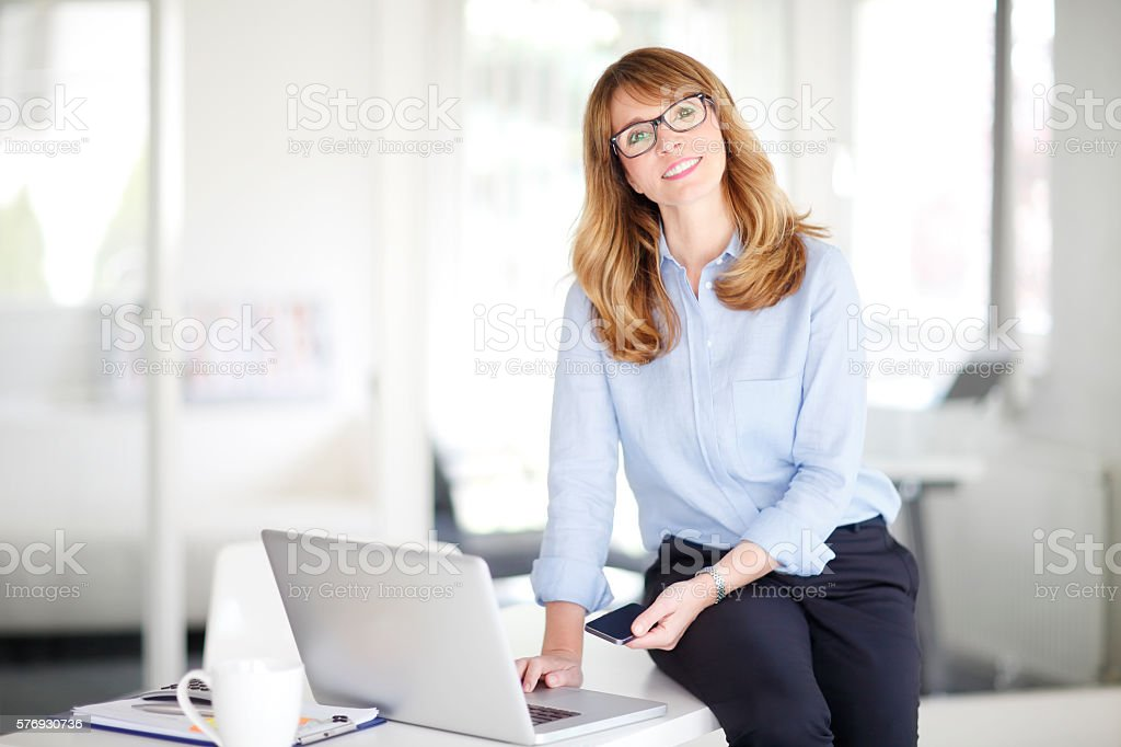Attractive businesswoman at office stock photo