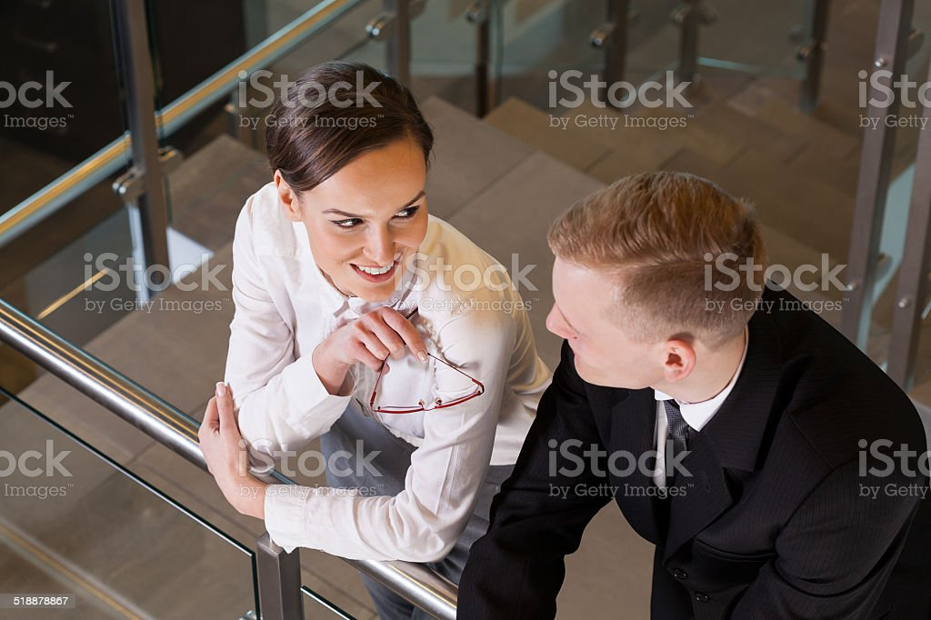 Attractive businesswoman coquetting her co-worker stock photo