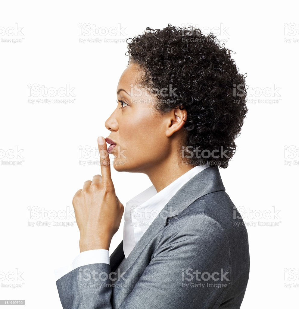 Attractive Businesswoman Gesturing Be Quiet - Isolated stock photo