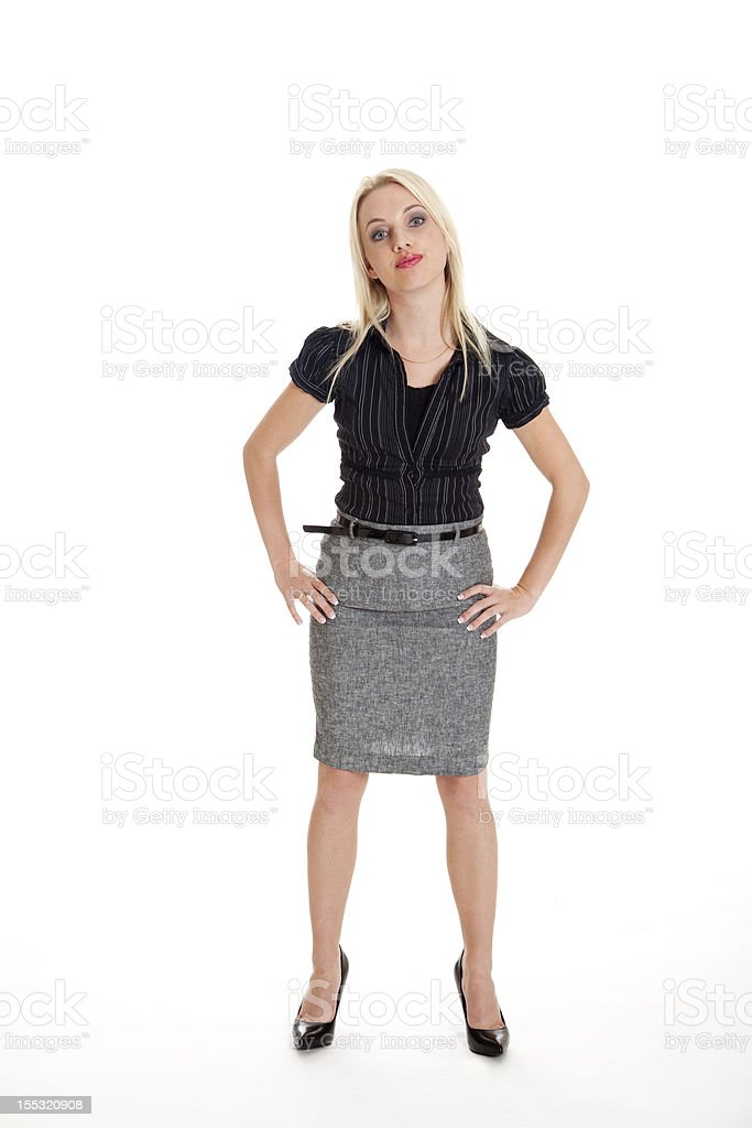 Attractive businesswoman in confrontational stance stock photo