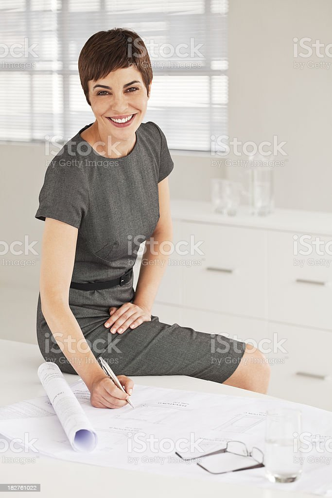 Attractive Businesswoman in Office Setting royalty-free stock photo