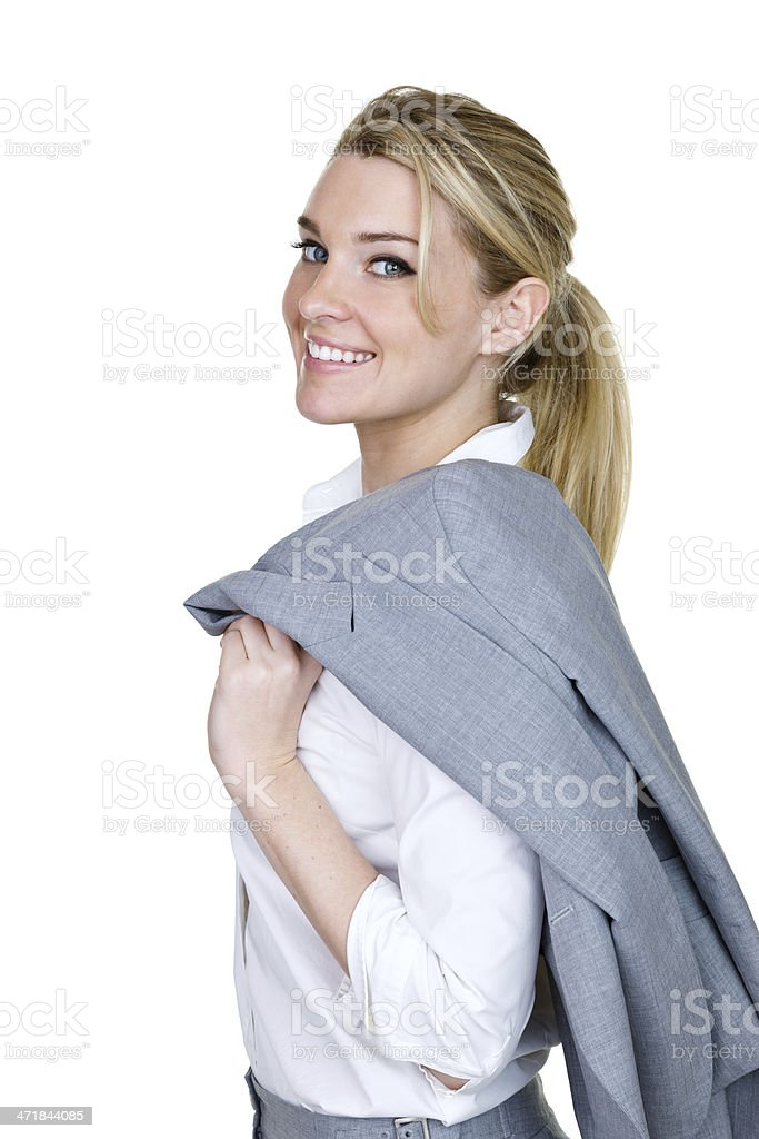 Attractive businesswoman looking back toward camera royalty-free stock photo