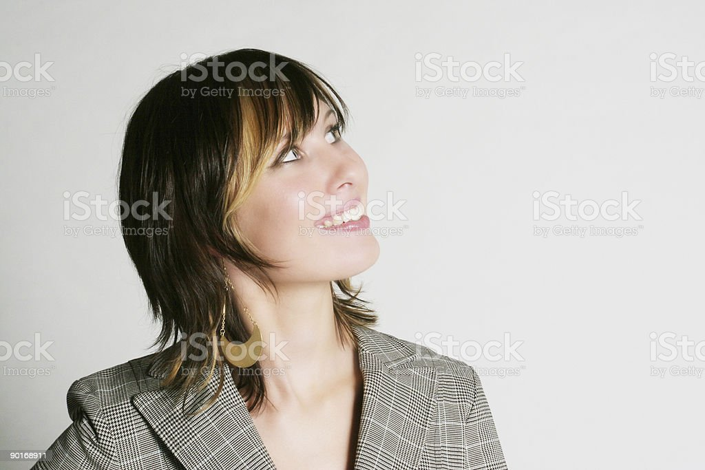 Attractive businesswoman looking up royalty-free stock photo