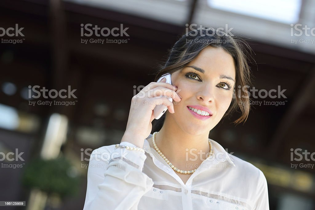 Attractive businesswoman on the phone in a office building royalty-free stock photo