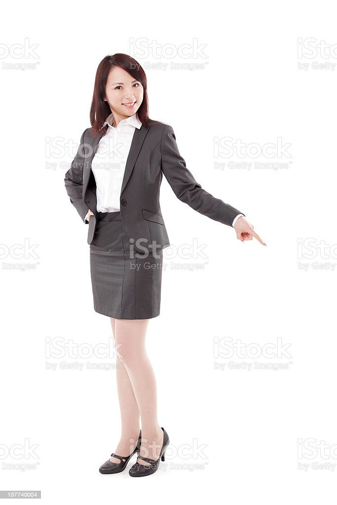 Attractive Businesswoman Pointing Down on White Background stock photo