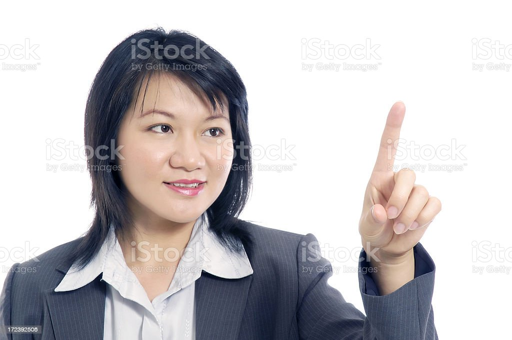 Attractive businesswoman pointing royalty-free stock photo