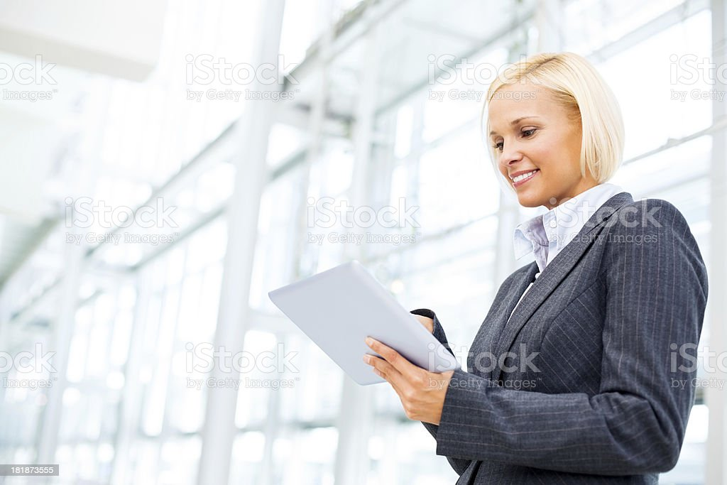 Attractive Businesswoman Using Digital Tablet royalty-free stock photo