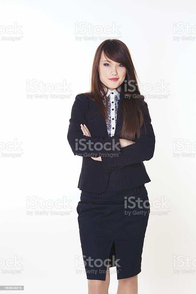 Attraktive Geschäftsfrau mit ihre Arme verschränkt Lizenzfreies stock-foto