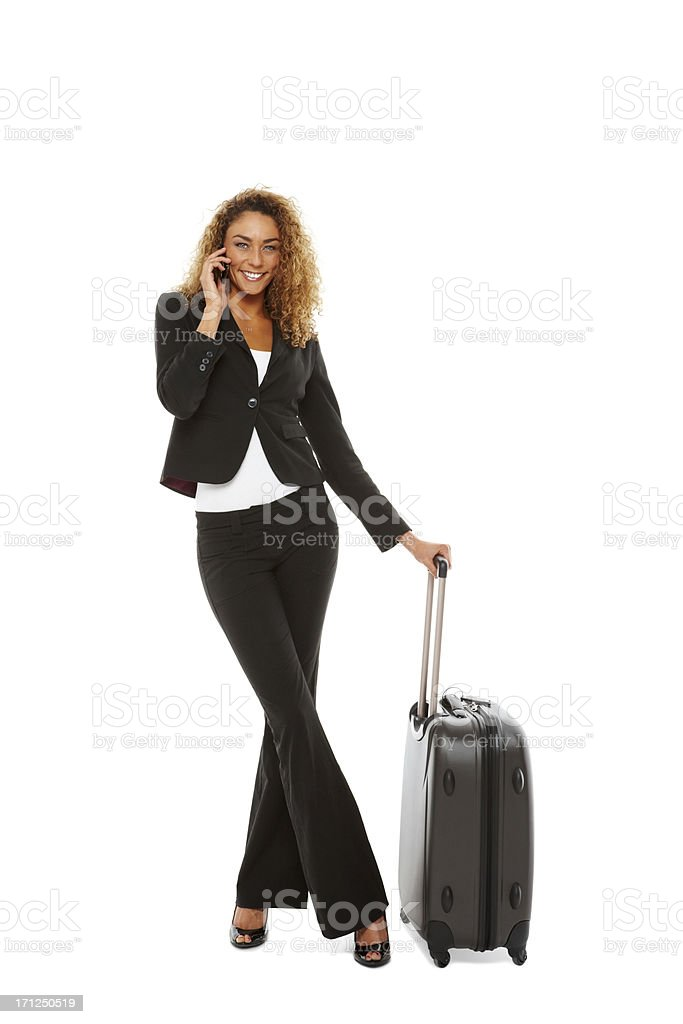Attractive businesswoman with suitcase making a phone call royalty-free stock photo