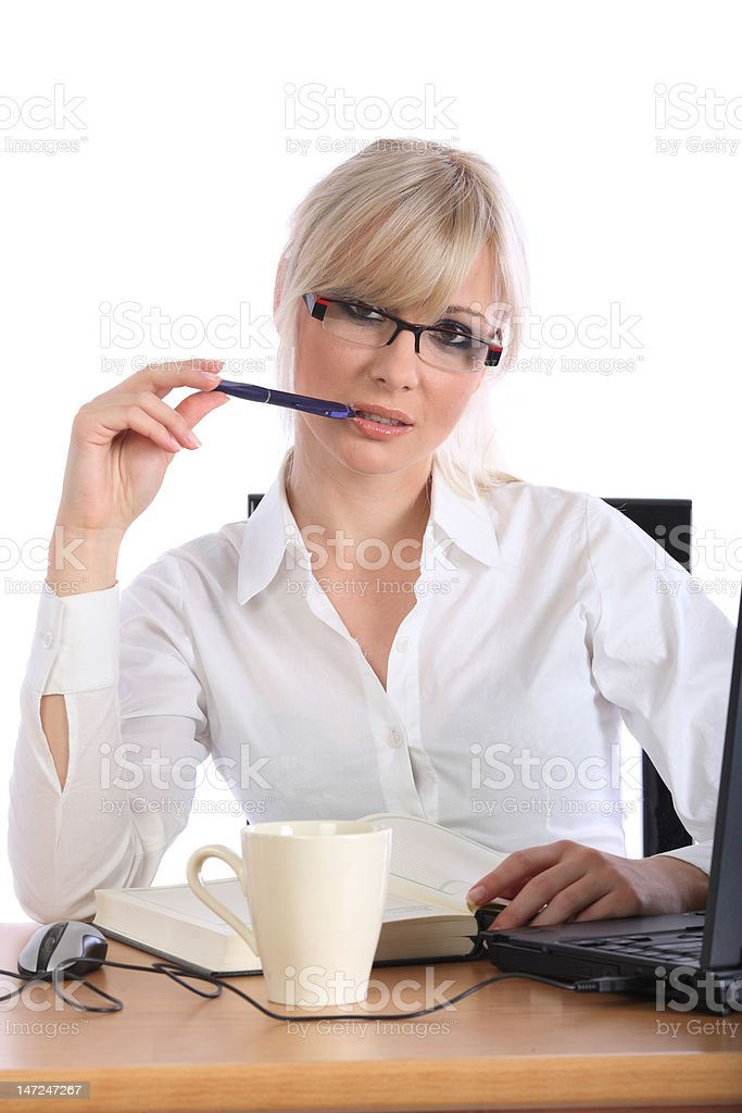 Attractive businesswoman with the pencil royalty-free stock photo