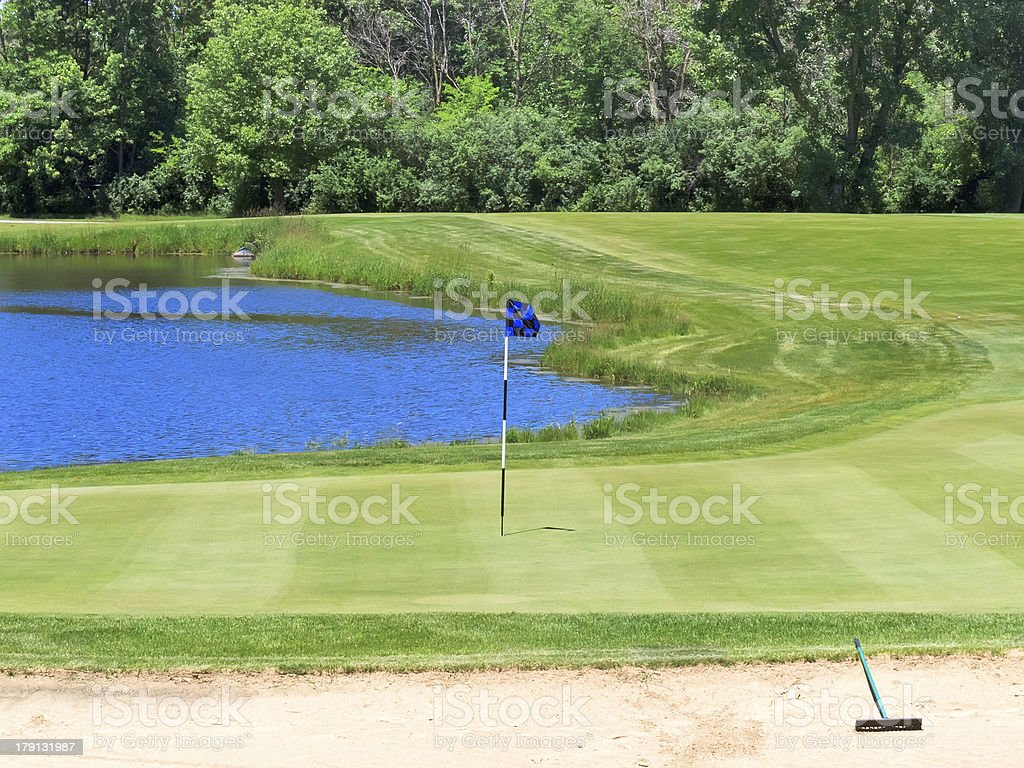 Attractive but potentially treacherous hole on golf course royalty-free stock photo