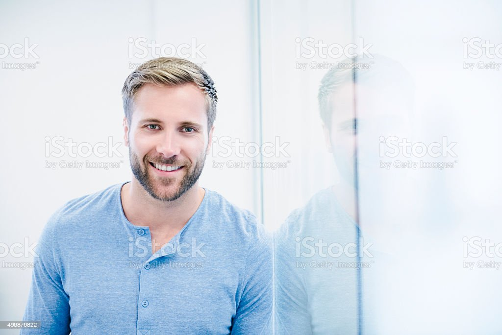 Attractive casual businessman with beard in modern office, portrait stock photo