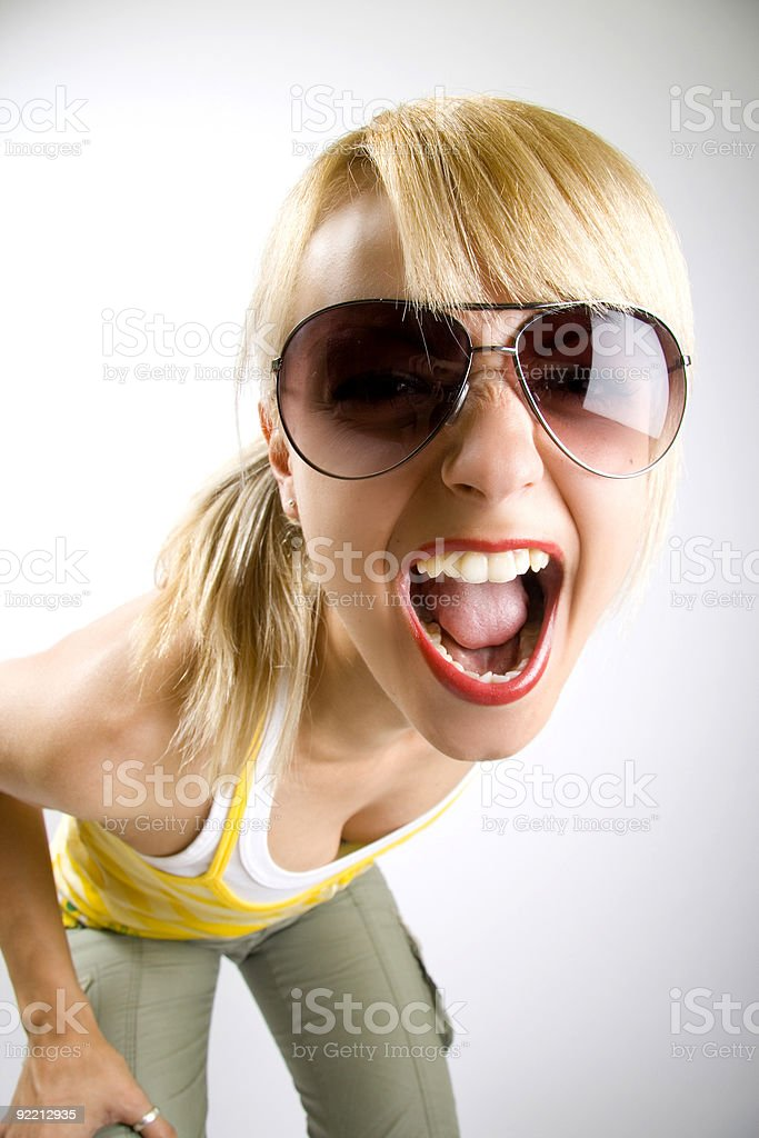attractive casual woman with sunglasses screaming royalty-free stock photo